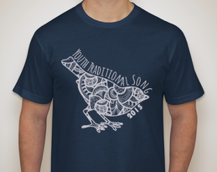 a stock image of a boxy-cut navy t-shirt with a white outline of a bird. the inside of the bird is filled with segments of paisley designs. The words youth traditional song 2015 surround the edge of the bird.